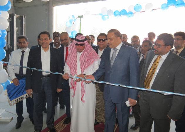 Mohammed Khurshid Al Buhmail, chairman of the Arja Al Khaleej Trading Group, cuts the ribbon.